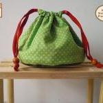 Reversible drawstring pouch..
